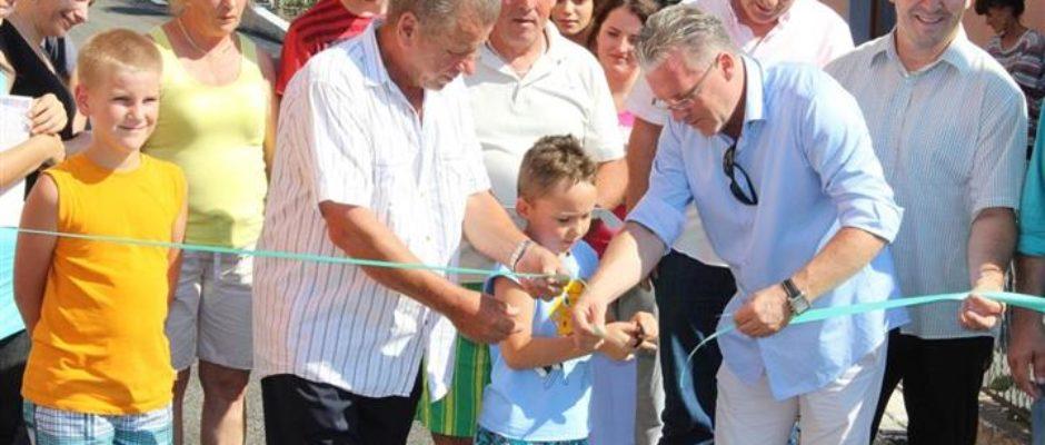 Asfaltiran i svečano otvoren Oluk, dio ulice Branilaca grada u naselju Krčana